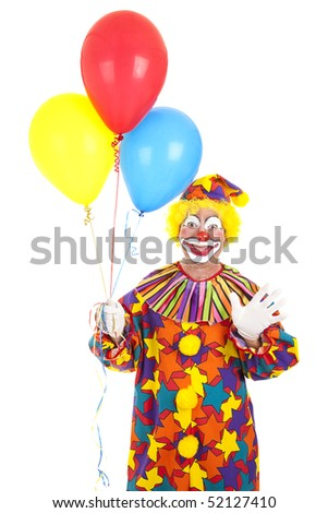 Clown holding a bunch of balloons and waving.  Isolated on white.