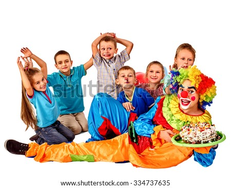 Clown holding cake on birthday with group happy kids. Isolated. - stock photo