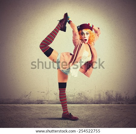 Clown in a pose extravagant and amazing - stock photo