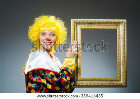 Clown in funny concept on dark background - stock photo