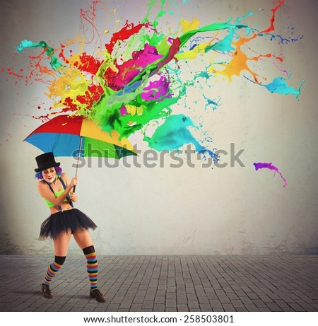 Clown is repaired by a colorful rain - stock photo