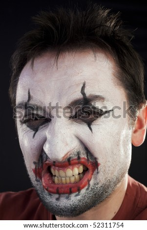 Clown looking at camera on a black background