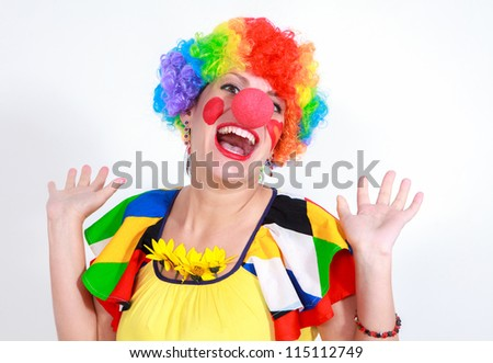Clown looking to the copy space area in a white studio - stock photo