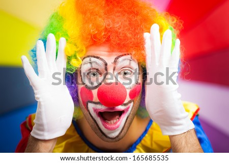 Clown making a funny face - stock photo