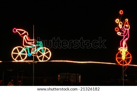 clown on the wire and kid on the bike - stock photo