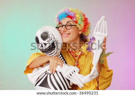 clown play with death studio shot - stock photo
