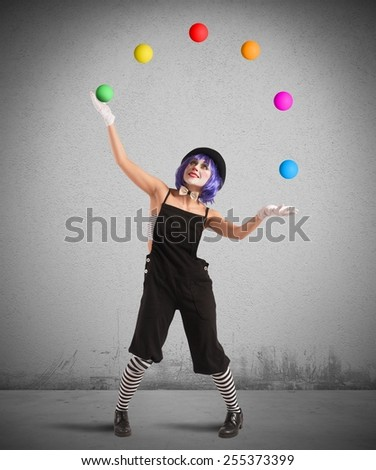 Clown playing with balls like a juggler - stock photo