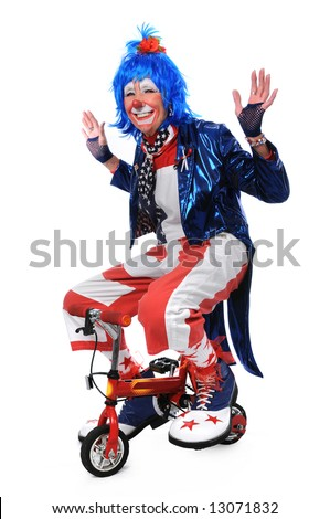 "Clown riding a small bicycle ""hands-off"" - stock photo"