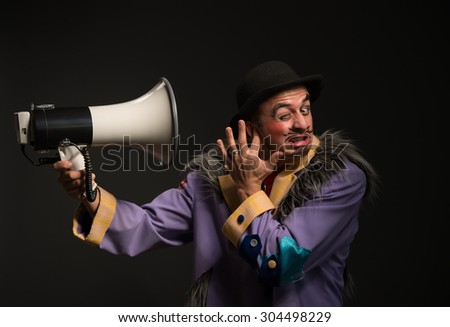 Clown shouting at the megaphone - stock photo