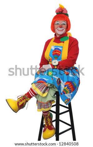 Clown sitting and smiling isolated over a white background - stock photo