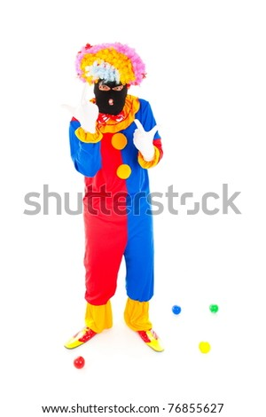 Clown using an Terrorist mask on white background .