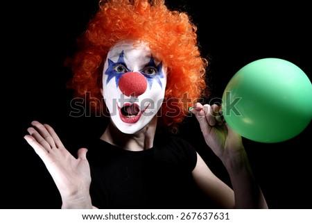 Clown with a balloon - stock photo