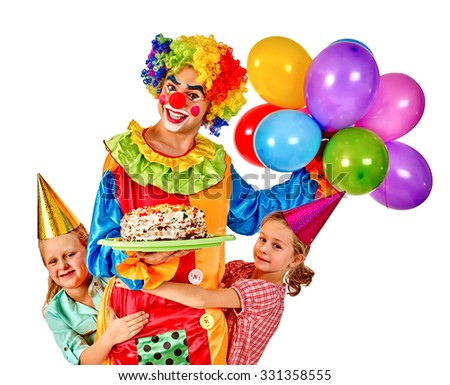 Clown with baloon holding cake on birthday group children. Isolated.
