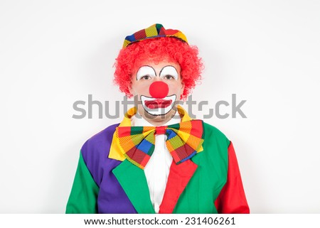 clown with neutral face on white - stock photo