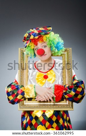 Clown with picture frame in funny concept - stock photo