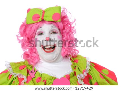 Clown with pink and green outfit laughing - stock photo