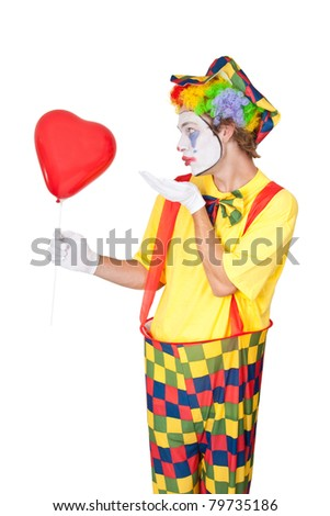 Clown with red heart shaped balloon - isolated - stock photo