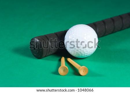 Club, golf ball and tees - stock photo