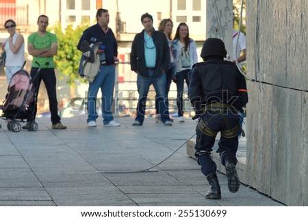 Club of stuntmen shows to people of the city a simulation of training of police special forces in Vilagarcia de Arousa, Galicia, Spain. June 16, 2014.