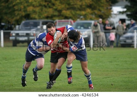 Club Rugby action, Canterbury New Zealand. Leeston center Justin Wolf drives through Southbrige defence. - stock photo