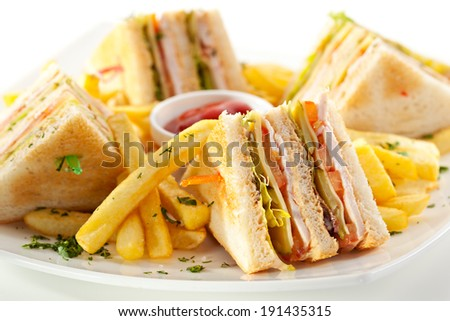 Club Sandwich with Cheese, PIckled Cucmber, Tomato and Smoked Meat. Garnished with French Fries - stock photo