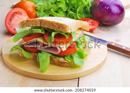 Club Sandwich with Cheese, Pickled Cucumber, Tomato and ham. Garnished with French Fries - stock photo
