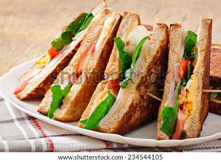 Club sandwich with chicken and ham - stock photo