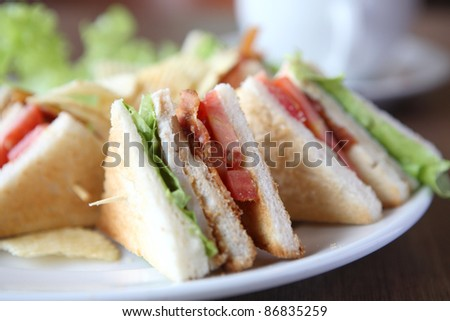 Club sandwich with coffee on wood background - stock photo