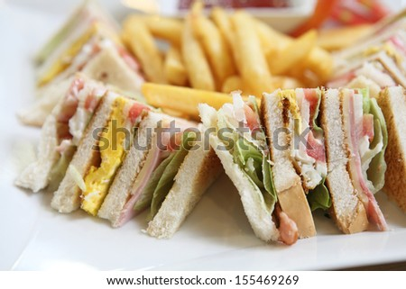 Club sandwich with on wood background - stock photo