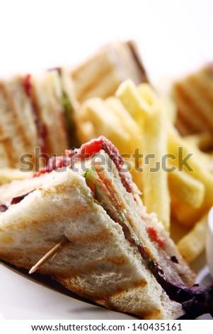 Club sandwich with salami and green - stock photo