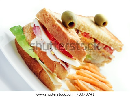 club sandwiches and french fries - stock photo