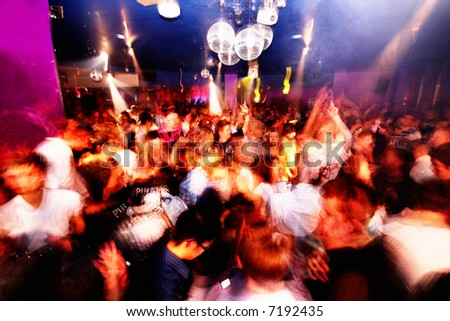 Club shot of a busy rave scene - stock photo
