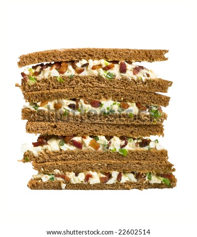 club tea sandwich with bacon and egg salad on whole grain bread - stock photo