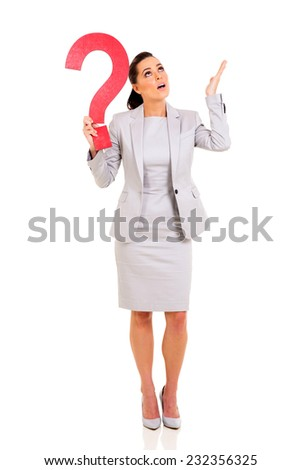 clueless businesswoman with question mark - stock photo