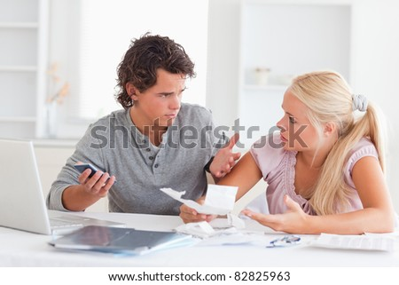 Clueless couple doing accounts in their living room