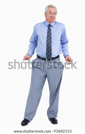 Clueless mature tradesman showing his empty pockets against a white background - stock photo