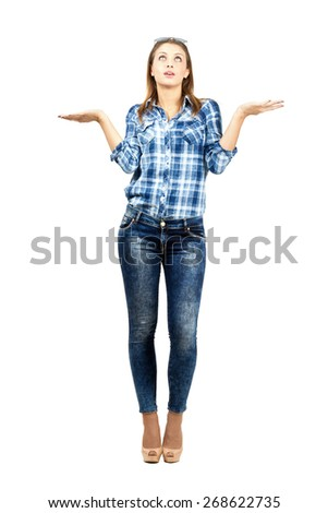 Clueless young student with raised arms and shoulders. Full body length portrait isolated over white background.  - stock photo