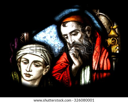CLUJ NAPOCA - DECEMBER 27: Biblical scene on a stained glass window inside the Gothic Roman Catholic Church of Saint Michael, built in 1390. On December 27, 2003 in Cluj, Romania            - stock photo