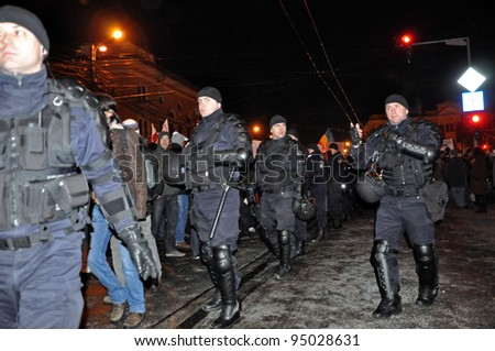 CLUJ NAPOCA - FEBRUARY 11: Special unit policemen controlling the street during a protest against ACTA, the web piracy treaty, and the government on February 11, 2012 in Cluj Napoca, Romania