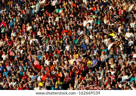CLUJ NAPOCA - MAY 20: Crowd of soccer fans of  FC 1907 CFR Cluj during a match against Steaua Bucharest, in the Constatntin Radulescu stadium, final score: 1-1. On May 20, 2012 in Cluj, Romania - stock photo