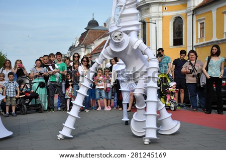 CLUJ NAPOCA - MAY 24: Parola Bianca theater group performing street theater on stilts, inside the Man.In.Fest during the Cluj Days of Cluj. On May 24, 2015 in Cluj, Romania - stock photo