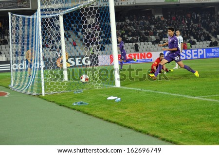 CLUJ-NAPOCA - NOVEMBER 7: UEFA Europa League: Matos Ryder from ACF Fiorentina kicks a goal against Pandurii Tragu Jiu, final score 2:1. On Nov. 7, 2013 in Cluj, Romania - stock photo