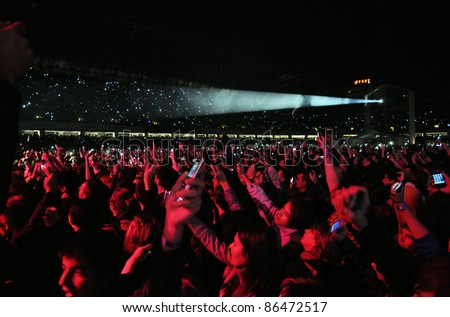 CLUJ NAPOCA – OCTOBER 8: Unidentified  fans at a sold out Scorpions live concert at Cluj Arena Grand Opening, on October 8, 2011 in Cluj Napoca, Romania - stock photo