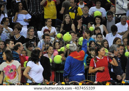 CLUJ-NAPOCA, ROMANIA - APRIL 16, 2016: Crowd of people supporting their favorite player during a Fed Cup tennis match in the World Cup Play-Offs, Romania vs Germany - stock photo