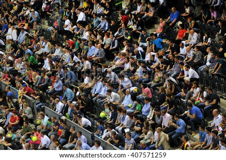 CLUJ-NAPOCA, ROMANIA - APRIL 17, 2016: Crowd of people supporting their favorite player during a Fed Cup tennis match in the World Cup Play-Offs, Romania vs Germany - stock photo