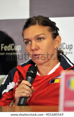 CLUJ-NAPOCA, ROMANIA - APRIL 13, 2016: Romanian tennis player Simona Halep answering questions during the press conference before Tennis Fed Cup World Cup Play-Offs match Romania vs Germany - stock photo