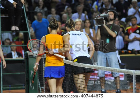 CLUJ-NAPOCA, ROMANIA - APRIL 16, 2016: Romanian tennis player Simona Halep won the Tennis Fed Cup play-offs match against Andrea Petkovic from Germany