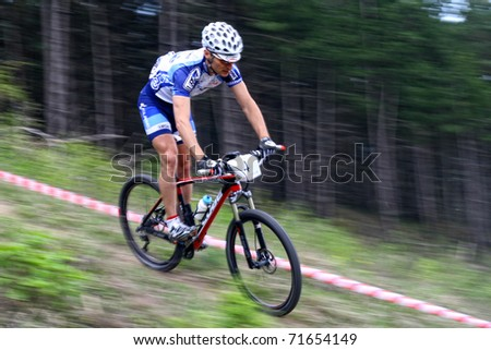 "CLUJ-NAPOCA, ROMANIA - APRIL 24: unknown Romanian biker in action at ""Maros Bike Downhill Marathon 2010"" on APRIL 24, 2010 ,Cluj-Napoca, Romania - stock photo"