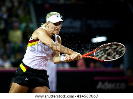 CLUJ-NAPOCA, ROMANIA - APRIL 16, 2016: Woman tennis player Angelique Kerber (WTA singles ranking 3) plays against Irina Begu during a Fed Cup match, play-offs between Romania and Germany - stock photo