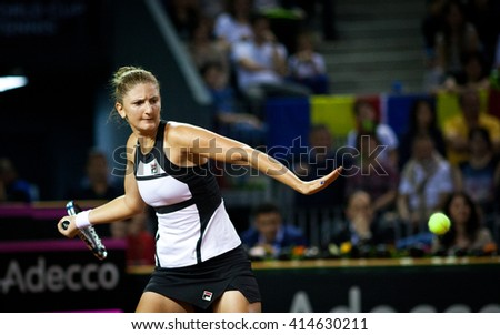 CLUJ-NAPOCA, ROMANIA - APRIL 16, 2016: Women tennis player Irina Begu (Romania) plays against Angelique Kerber (Germany) during Tennis Fed Cup play-offs - stock photo